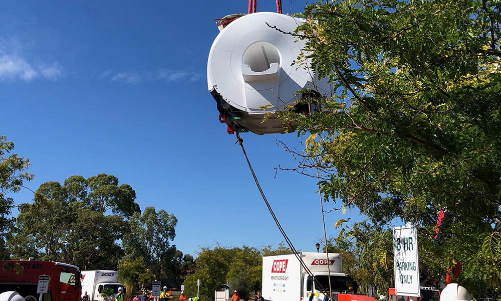 Dr Jones new MRI machine being crane lifted at the Gawler clinic