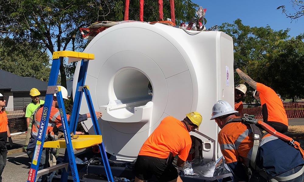 Dr Jones new MRI machine being unloaded at the Gawler clinic